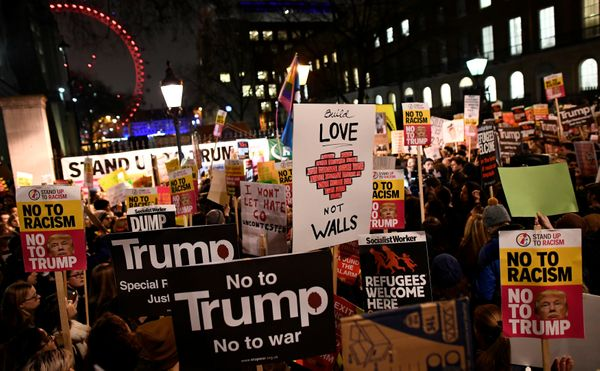 """Demonstrators in the British capital held placards reading, """"Love, not walls,"""" and """"No to racism, No to Trump."""""""