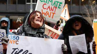 Demonstrators gather protesting climate change outside the office of U.S. Senator Charles Schumer (D-NY) in New York, U.S., January 9, 2017. REUTERS/Shannon Stapleton     TPX IMAGES OF THE DAY