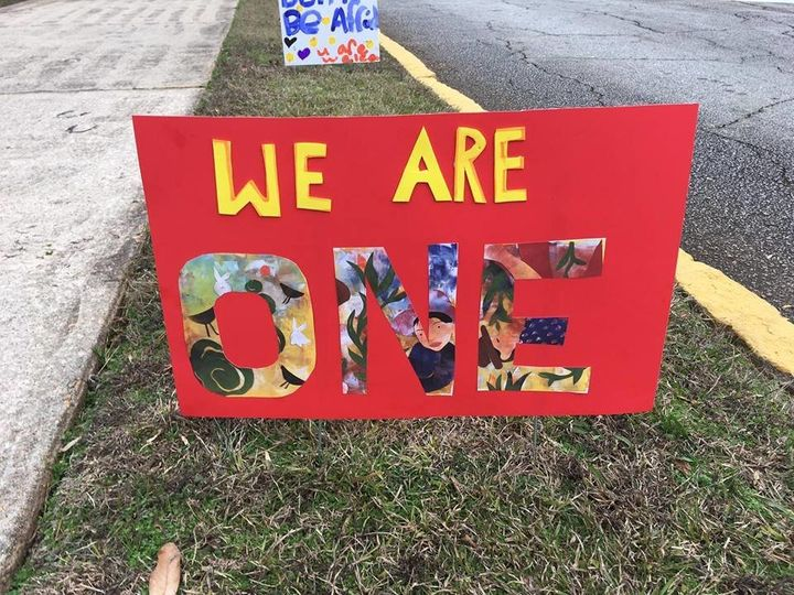 "A sign that reads: ""We are one."""