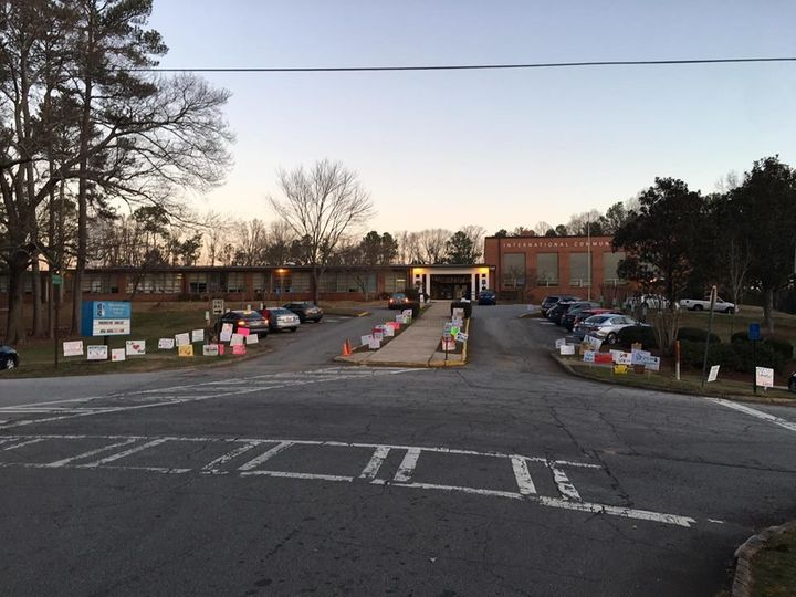 The signs that are currently in front of the school.