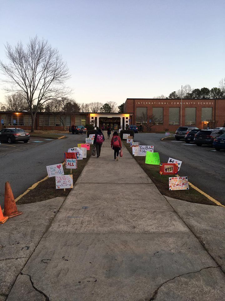 Signs planted by the school's walkway on Monday morning.
