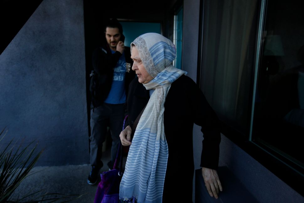 Marzieh Moosavizadeh and her grandson leave their hotel room in El Segundo after she was detained at LAX Jan. 29, 2017 in Los