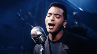 Pop vocalist Jon Secada sings during the filming of a music video in San Fernando Valley. (Photo by Henry Diltz/Corbis via Getty Images)