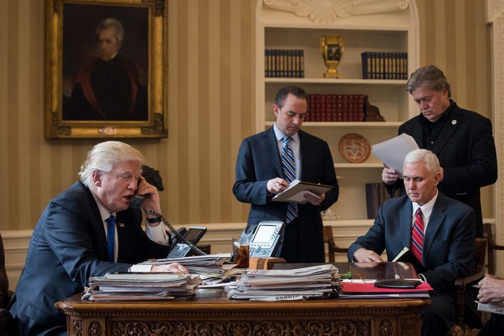 President Donald Trump speaks on the phone with Russian President Vladimir Putin in the Oval Office of the White House, Jan.