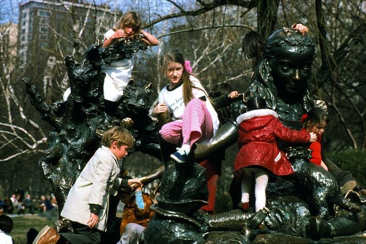 Kids play on the Alice in Wonderland statue in Central Park circa 1960.