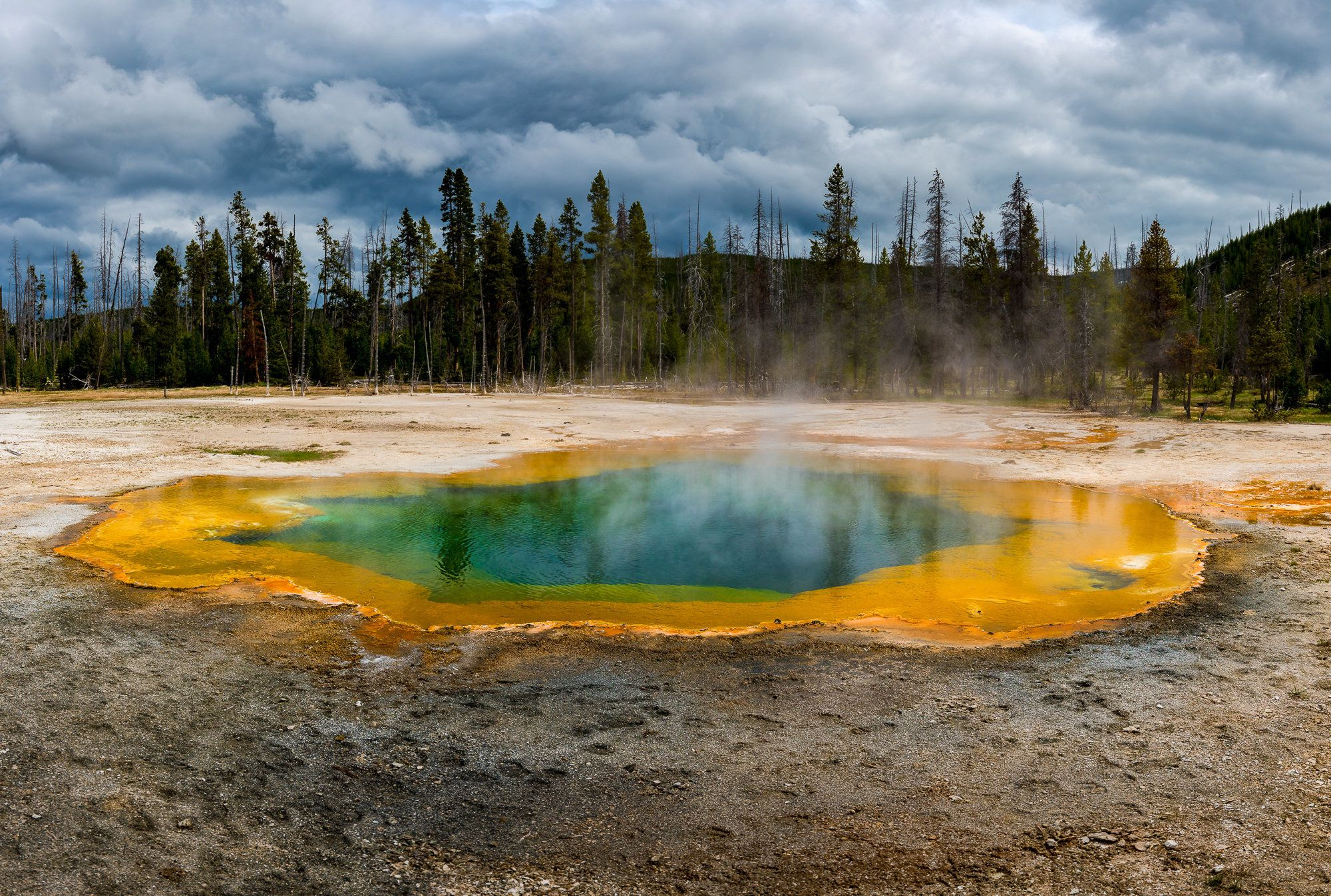 *** EXCLUSIVE ***  YELLOWSTONE NATIONAL PARK, WY - MAY 2016: The pools steam and bubble, reminding you that this volcano is well overdue an eruption, taken in May 2016, in Yellowstone National Park, Wyoming, United States.  WITNESSING the beautiful spectrum of colours in Yellowstone National Park springs, you could almost forget youre standing on a supervolcano way past its eruption due date. The extraterrestrial-looking mineral-rich pools are caused by bacteria and thermophiles growing around the edges, creating the striking colours. The heat from three super eruptions thousands of years ago still powers the parks geysers, hot springs, fumaroles and mud pots, indicating how frighteningly active this volcano is directly under visitors feet.  PHOTOGRAPH BY Russell Pearson / Barcroft Images   London-T:+44 207 033 1031 E:hello@barcroftmedia.com - New York-T:+1 212 796 2458 E:hello@barcroftusa.com - New Delhi-T:+91 11 4053 2429 E:hello@barcroftindia.com www.barcroftmedia.com (Photo credit should read Russell Pearson /Barcroft Images / Barcroft Media via Getty Images)