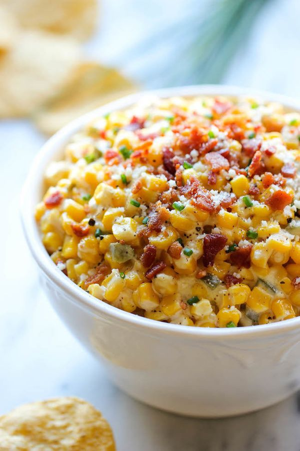"<strong>Get the <a href=""http://damndelicious.net/2014/02/28/slow-cooker-corn-jalapeno-dip/"" target=""_blank"">Slow Cooker Corn"