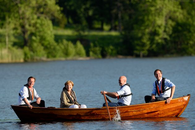 The sinking feeling: Cameron, Merkel and and Dutch Prime Minister Mark Rutte enjoy a spot of