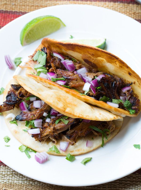 """<strong>Get the <a href=""""http://www.aspicyperspective.com/slow-cooker-carnitas/"""" target=""""_blank"""">Slow Cooker Carnitas recipe<"""