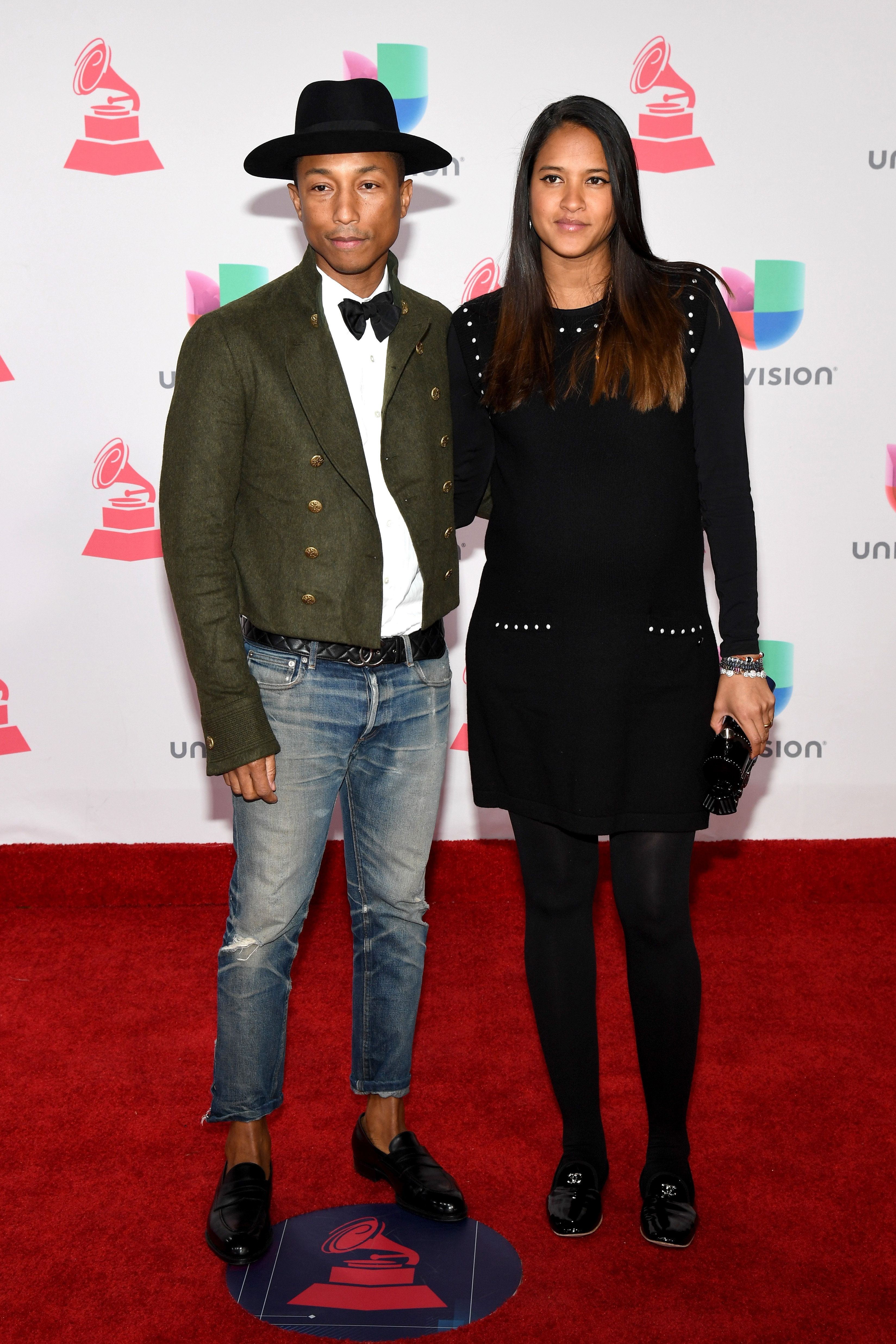 LAS VEGAS, NV - NOVEMBER 17:  Pharrell Williams (L) and Helen Lasichanh attend The 17th Annual Latin Grammy Awards at T-Mobile Arena on November 17, 2016 in Las Vegas, Nevada.  (Photo by Ethan Miller/Getty Images )