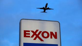 An airplane comes in for a landing above an Exxon sign at a gas station in the Chicago suburb of Norridge, Illinois, U.S., October 27, 2016. REUTERS/Jim Young