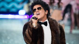 PARIS, FRANCE - NOVEMBER 30:  Bruno Mars performs at the Victoria's Secret Fashion Show on November 30, 2016 in Paris, France.  the 2016 Victoria's Secret Fashion Show on November 30, 2016 in Paris, France.  (Photo by Francois G. Durand/WireImage)