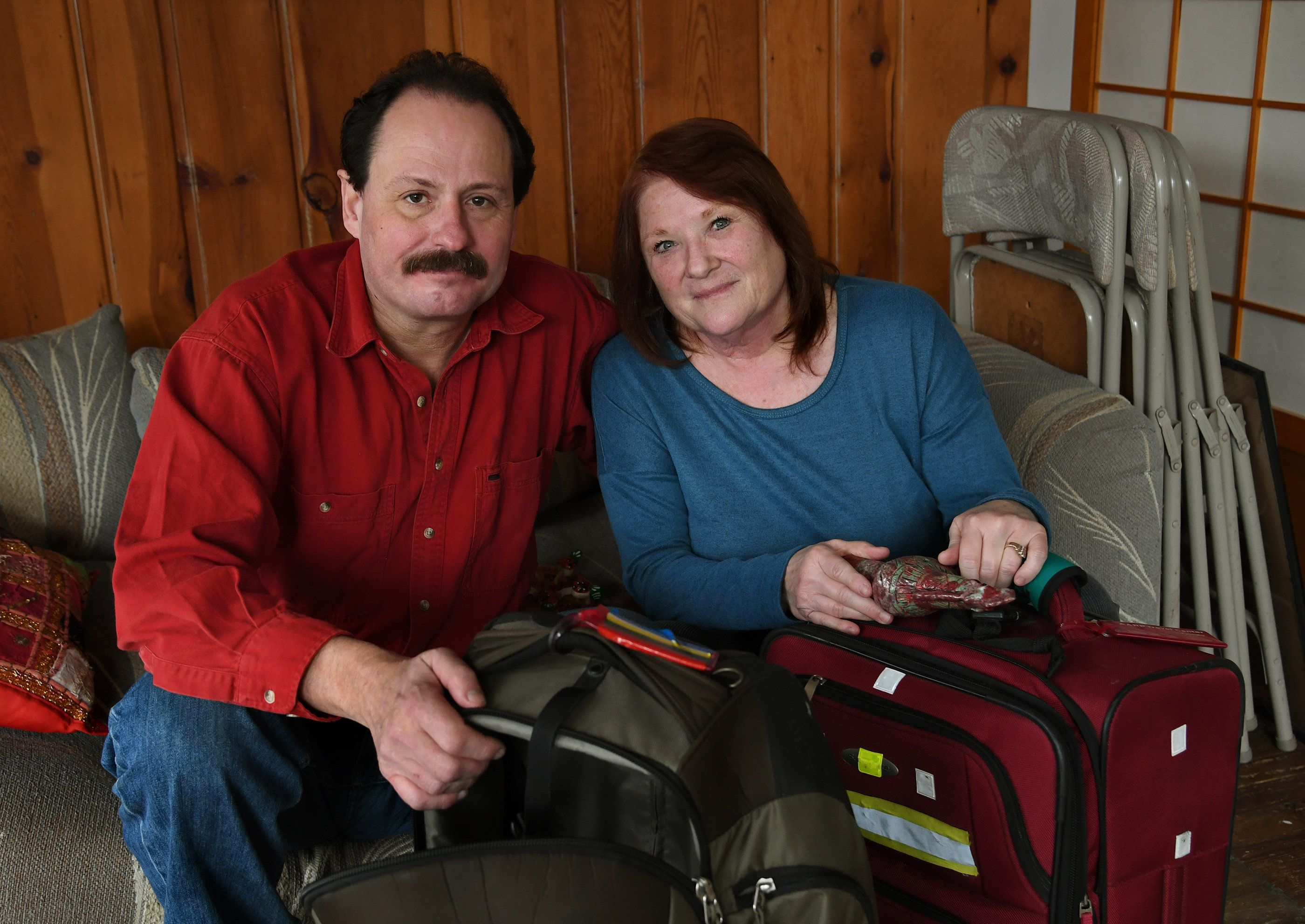 ACCOKEEK, MD-JAN 18: (L) Jeff Yeager and his wife Denise (with suitcases and trinkets from previous trips) are the rare individuals who threatened to leave the country if Trump was elected president, and actually are. The Yeager's may even sell their Accokeek home. They've already visited Ireland, plan to go next to Central America, then onto Eastern Europe (and Russia) on their year-long quest to find a new home for four years. Or eight. (Photo by Michael S. Williamson/The Washington Post via Getty Images)