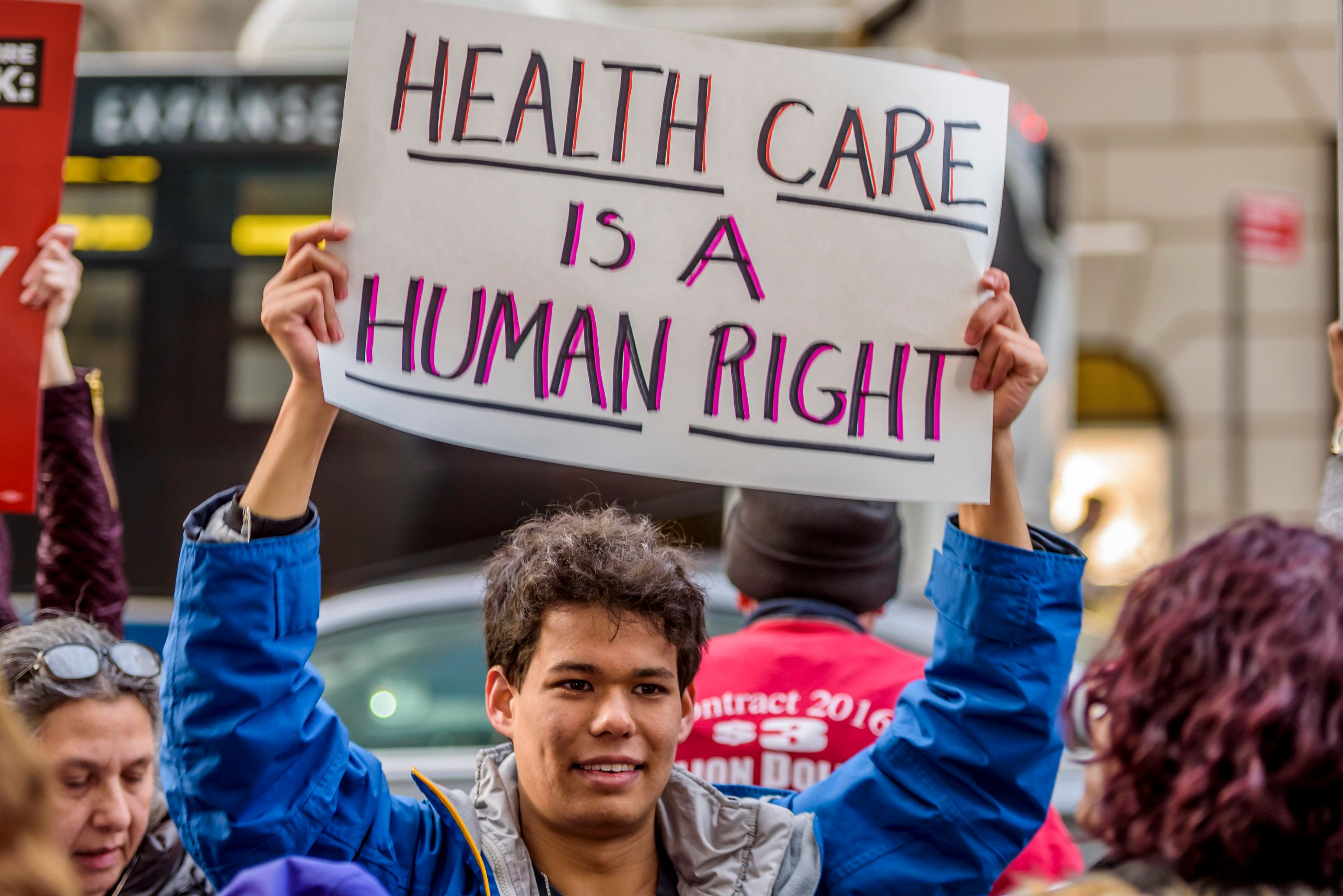 Protesters gather outside Trump Tower on Jan. 13 to remind the president whyObamacare matters.