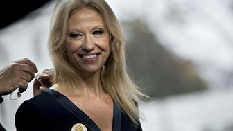 Kellyanne Conway, senior advisor to U.S. President Donald Trump, smiles before a television interview outside the White House in Washington, D.C., U.S., on Sunday, Jan. 22, 2017. Conway, a key adviser to Trump, said today the new administration plans to end the Affordable Care Acts requirement that most people have health insurance, a step that could destabilize the laws markets. Photographer: Andrew Harrer/Bloomberg via Getty Images
