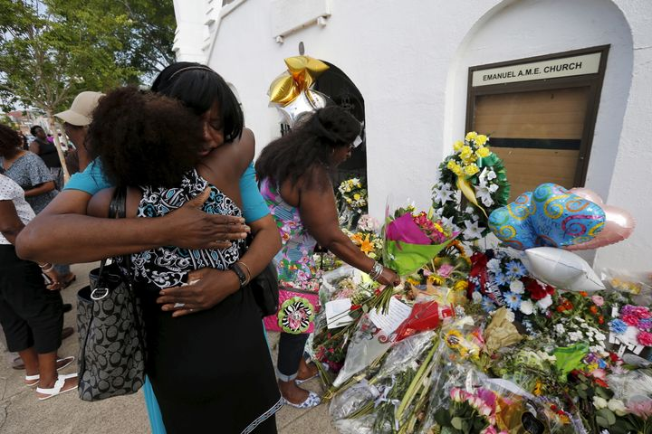 Kumba Mboma and Lucinda Maywood hug at a makeshift memorial outside the Emanuel African Methodist Episcopal Church in Charles