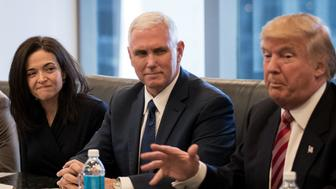 NEW YORK, NY - DECEMBER 14: (L to R) Sheryl Sandberg, chief operating officer of Facebook, and Vice President-elect Mike Pence listen as President-elect Donald Trump speaks during a meeting of technology executives at Trump Tower, December 14, 2016 in New York City. This is the first major meeting between President-elect Trump and technology industry leaders. (Photo by Drew Angerer/Getty Images)