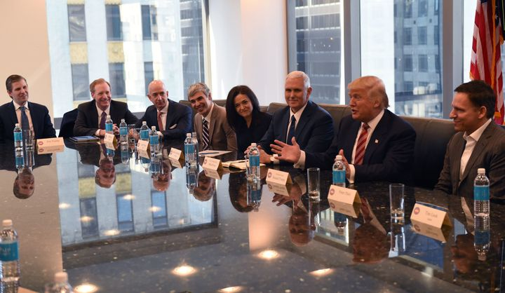 (L-R) Eric Trump, Amazon's chief Jeff Bezos, Larry Page of Alphabet, Facebook COO Sheryl Sandberg, Pence, Trump and Pete