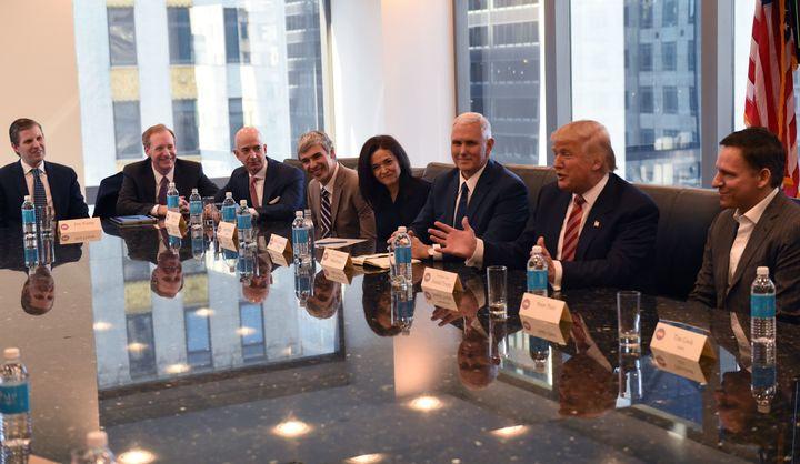 (L-R) Eric Trump, Amazon's chief Jeff Bezos, Larry Page of Alphabet, Facebook COO Sheryl Sandberg, Pence, Trumpand Pete