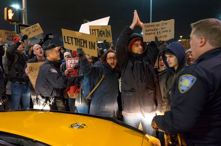 Protesters temporarily block an intersection at JFK International Airport in New York on Saturday. A strike by taxi drivers t