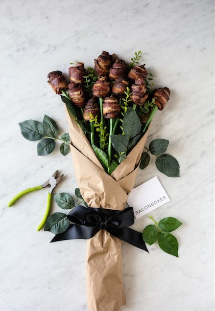 "Flowers are such a cliche on Valentine's Day, it's better to ham things up with these <a href=""https://www.baconboxes.com/bac"