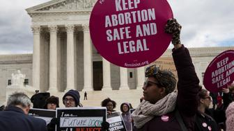 Abortion rights supporters and pro-life supporters protest outside the US Supreme Court during the 44th annual March for Life on January 27, 2017 in Washington, DC. Anti-abortion activists are gathering for the 44th annual March for Life in Washington, protesting the 1973 Supreme Court decision legalizing abortion. / AFP / ZACH GIBSON        (Photo credit should read ZACH GIBSON/AFP/Getty Images)