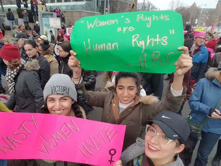 Tamana Riviere, right, with her sisters at the Women's March in Toronto.