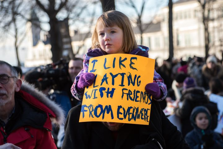 In New York, a young protester rallies against Donald Trump's executive order on immigration.