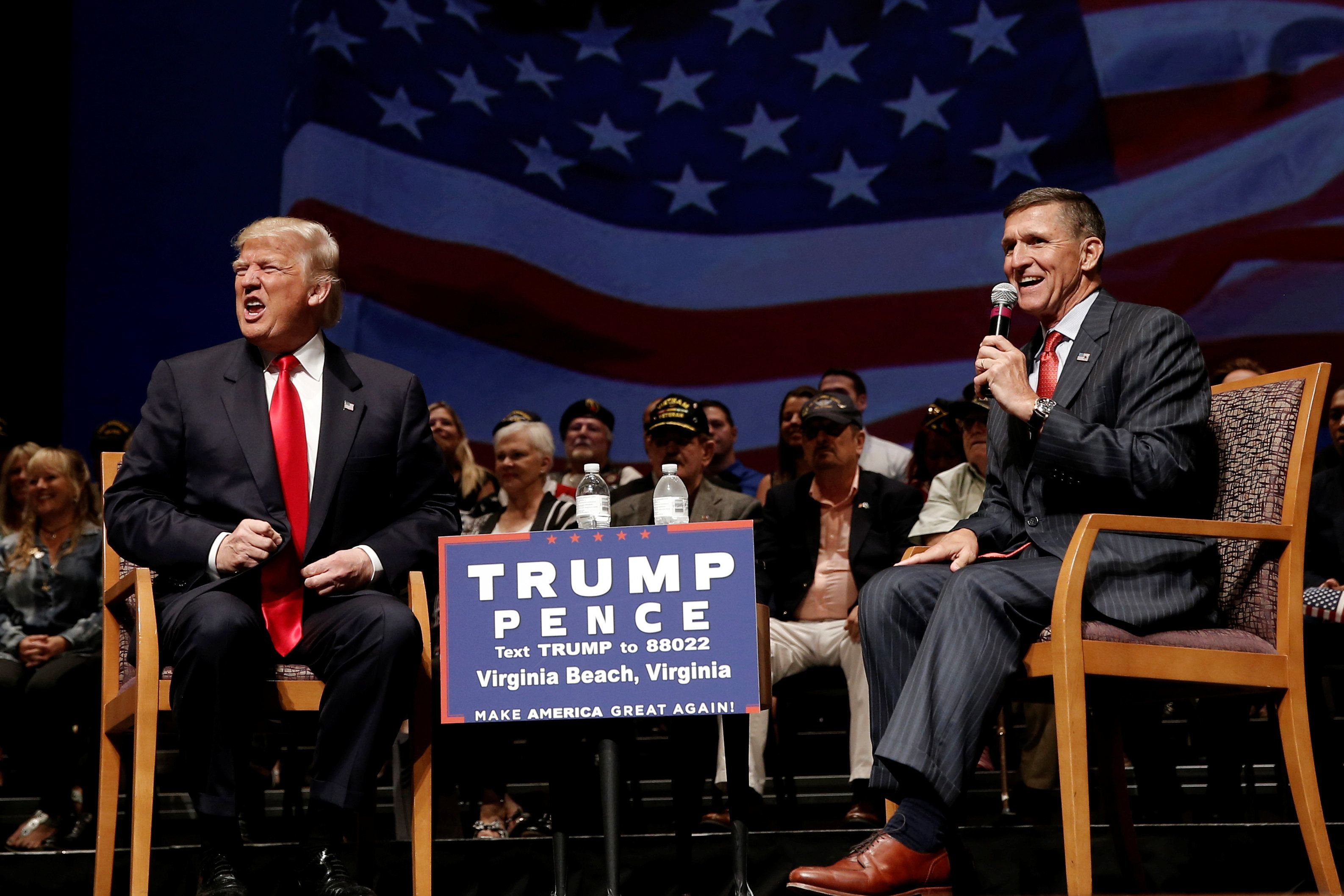 Republican presidential nominee Donald Trump (L) speaks along side retired U.S. Army Lieutenant  General Mike Flynn during a campaign town hall meeting in Virginia Beach, Virginia, U.S., September 6, 2016.  REUTERS/Mike Segar