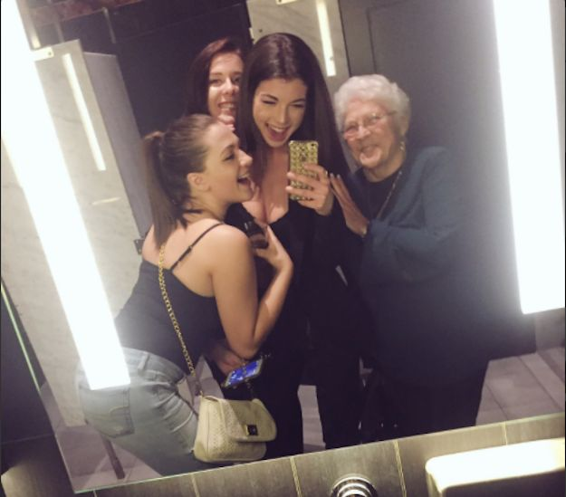 Mahri Smith, her friends and a lovely stranger snap a selfie.