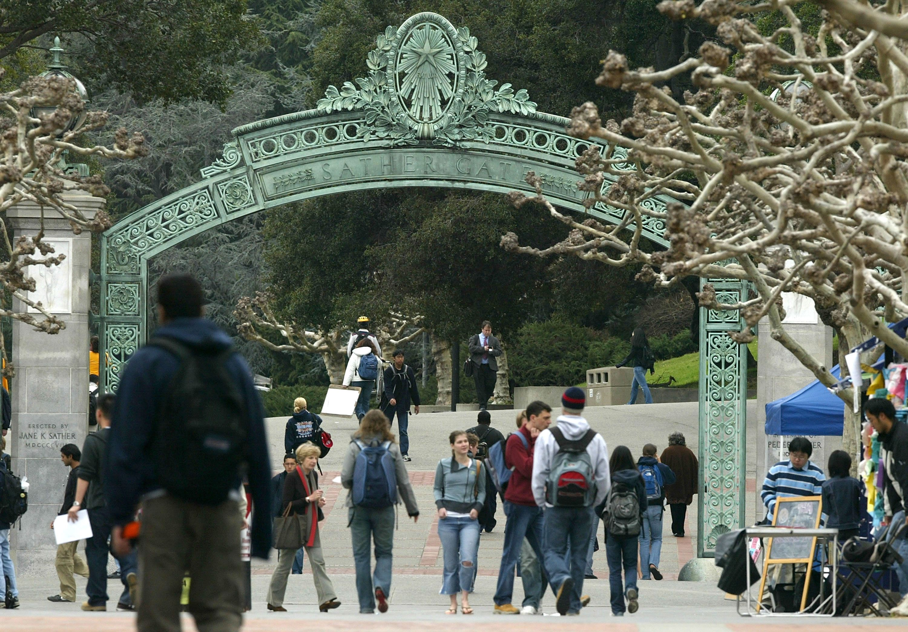 BERKELEY, CA - FEBRUARY 24:  Students walk near Sather Gate on the University of California at Berkeley campus February 24, 2005 in Berkeley, California. The City of Berkeley is suing U.C. Berkeley citing that university administrators did not adequately evaluate the consequences to the city with its 15-year growth plan and hopes to block construction of any new projects.  (Photo by Justin Sullivan/Getty Images)