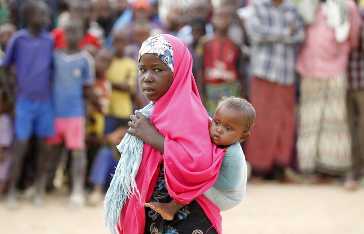 A Somali refugee child carries her sibling in Dadaab, the refugee camp near the Kenya-Somalia border, May 8, 2015. Dadaab is