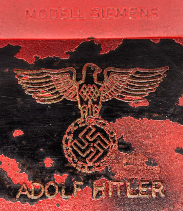 The Siemens phone also has a swastika and NSDAP eagle inscribed above Hitler's