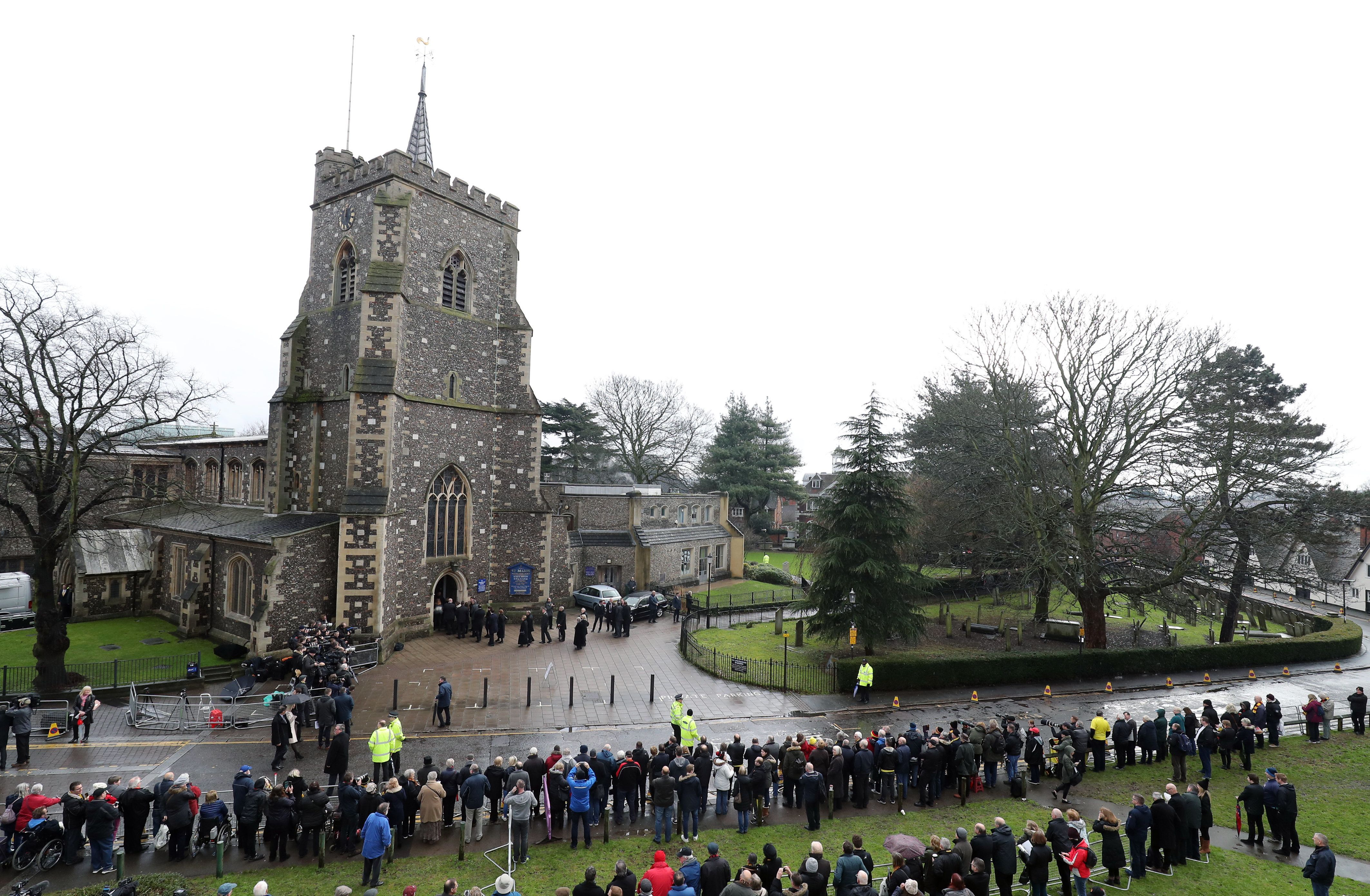 Crowds arrive for the funeral in Watford on
