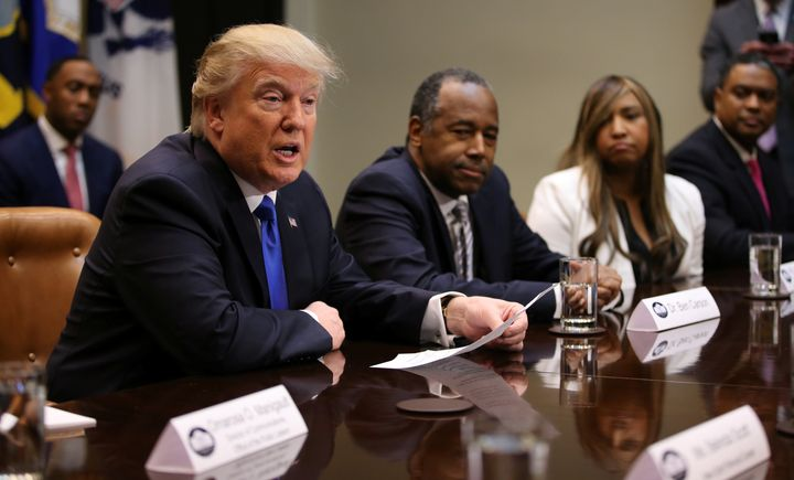 President Donald Trump and Dr. Ben Carson, nominated to be the next secretary of housing and urban development, attend a Blac