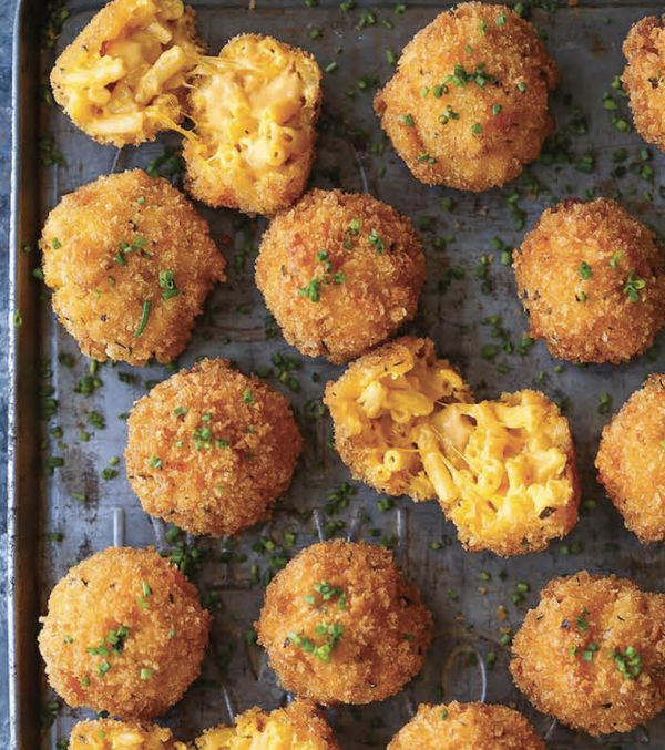 "<strong>Get the <a href=""http://damndelicious.net/2016/11/27/fried-mac-cheese-balls/"" target=""_blank"">Fried Mac And Cheese Ba"