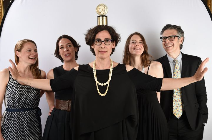 Sarah Koenig, center, poses with her Peabody award.