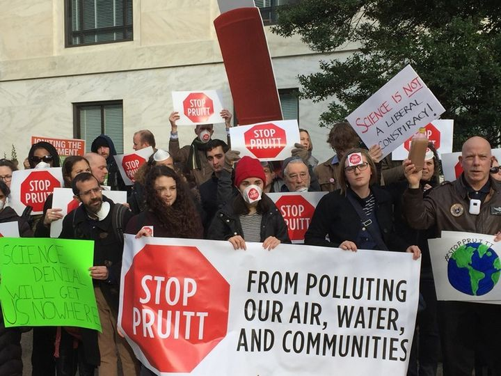 Protesters rally against Scott Pruitt for head of the EPA.