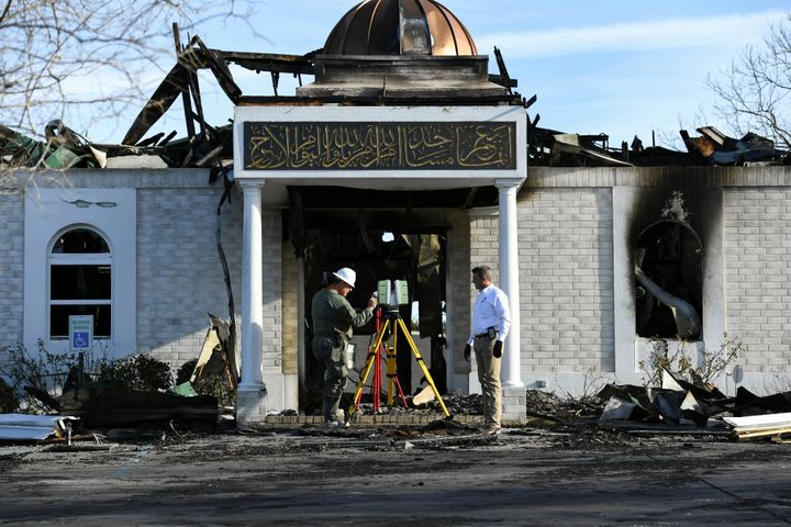 Security officials investigate the aftermath of a fire at the Victoria Islamic Center mosque in Victoria, Texas on Jan. 29, 2