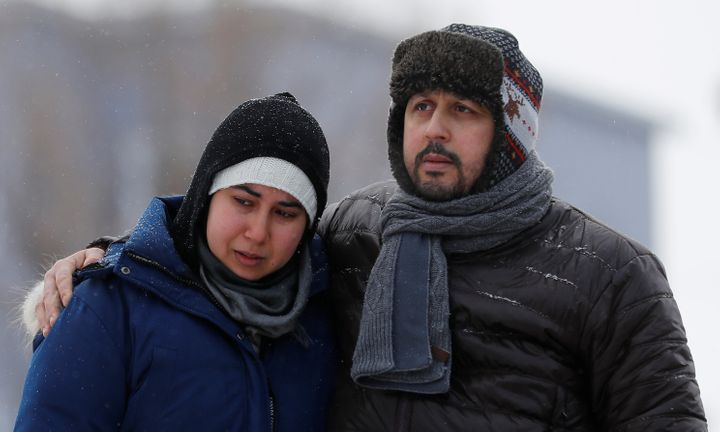 Azzedine Najd (R) and his wife Fadwa Achmaoui look at the memorial near the site of a fatal shooting at the Quebec Islamic Cu