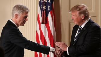 WASHINGTON, DC - JANUARY 31:  U.S. President Donald Trump (R) shakes hands with Judge Neil Gorsuch after nominating him to the Supreme Court during a ceremony in the East Room of the White House January 31, 2017 in Washington, DC. If confirmed, Gorsuch would fill the seat left vacant with the death of Associate Justice Antonin Scalia in February 2016.   (Photo by Chip Somodevilla/Getty Images)