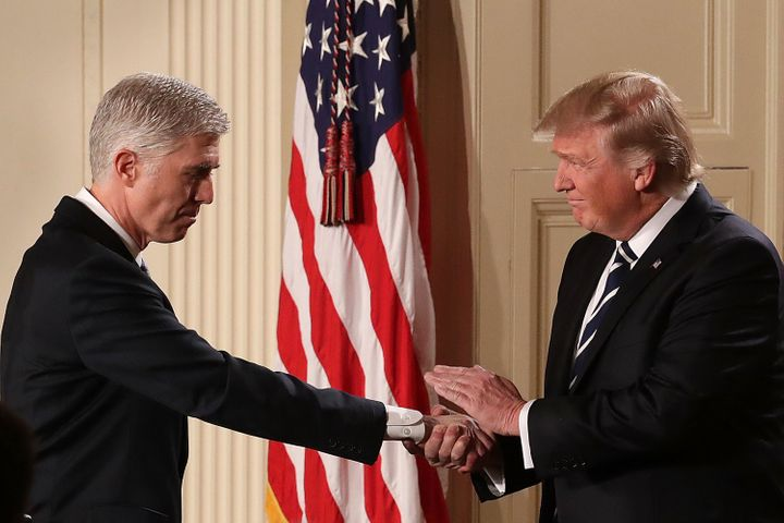 President Donald Trump shakes hands with Judge Neil Gorsuch after nominating him to the Supreme Court.