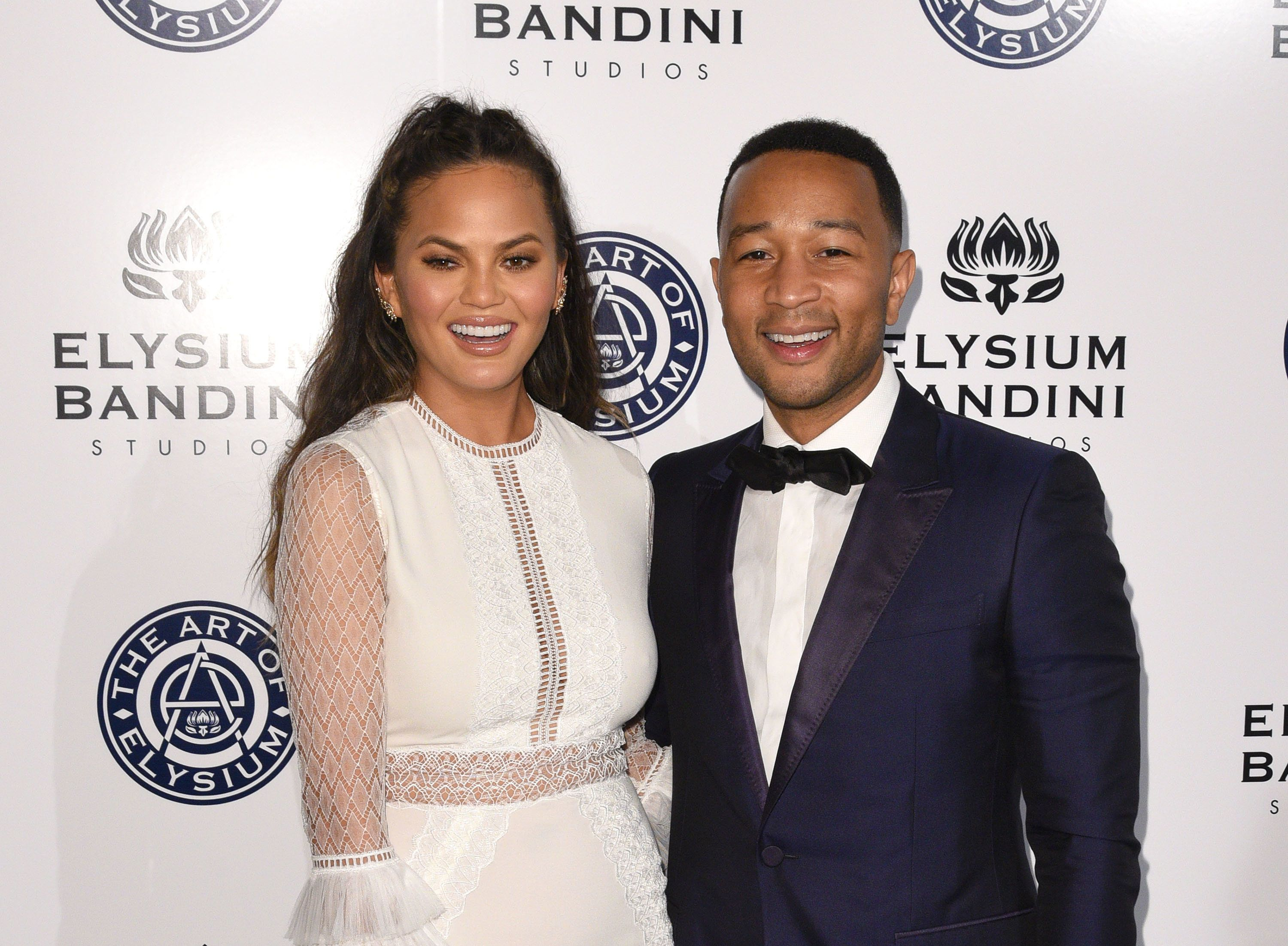 Chrissy Teigen Slams Troll Who Asked Why She Didn't 'Try Naturally' To