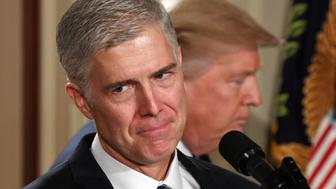 WASHINGTON, Jan. 31, 2017  -- Judge Neil Gorsuch (L) speaks after U.S. President Donald Trump nominated him for the Supreme Court, at the White House in Washington, D.C., the United States, Jan. 31, 2017. U.S. President Donald Trump announced Tuesday night he picked judge Neil Gorsuch as the new justice for the Supreme Court, which has been evenly divided between Democratic appointees and Republican ones since Justice Antonin Scalia died last February. (Xinhua/Yin Bogu via Getty Images)