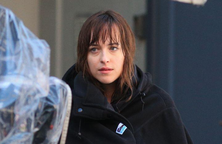 <em>Dakota Johnson as Anastasia Steele on the set of Fifty Shades of Grey</em>