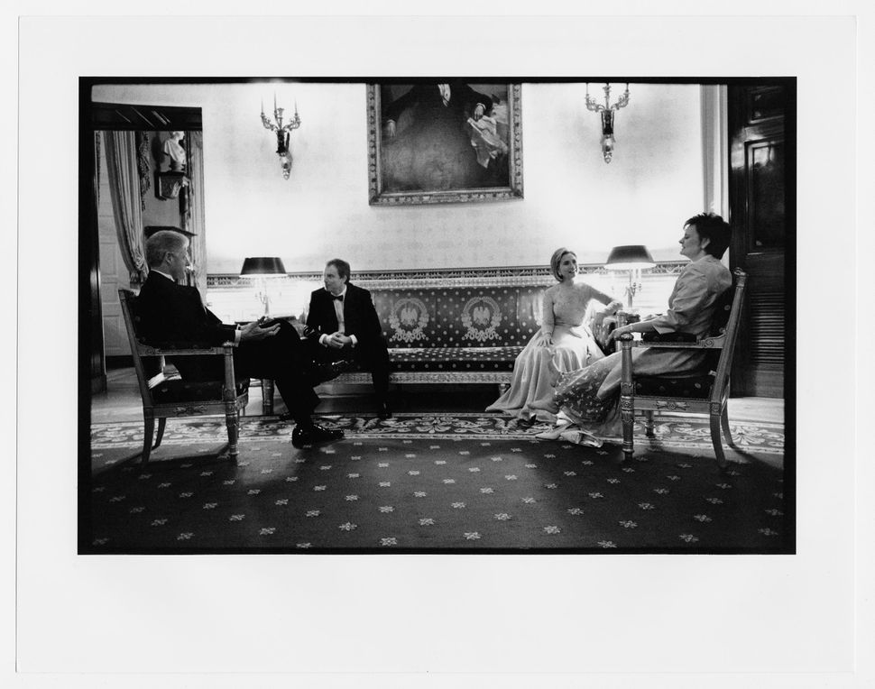 The Clintons, with British Prime Minister Tony Blair and Cherie Blair, rest after a receiving line before a state dinner. Feb