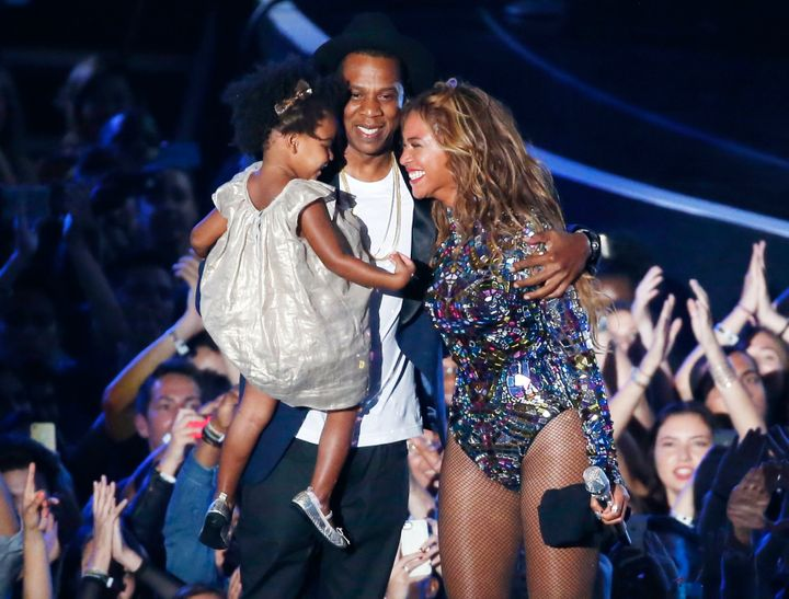 Beyonce smiles with Jay-Z and daughter Blue Ivy after accepting the Video Vanguard Award on stage during the 2014 MTV Video Music Awards in Inglewood, California August 24, 2014. REUTERS/Lucy Nicholson (UNITED STATES - Tags: ENTERTAINMENT) (MTV-SHOW)