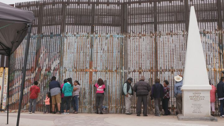 Beyond Borders Film- Mother visiting her child at the San Diego/Tijuana Wall.