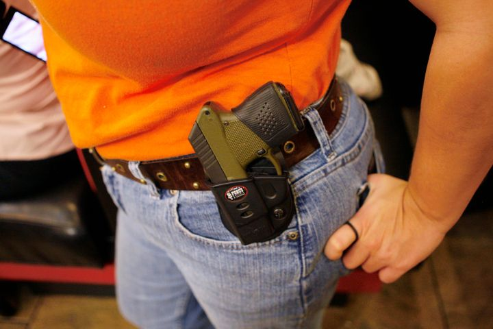 Morgan Meritt of Del City, Oklahoma, wears an unconcealed weapon at Beverly's Pancake House in Oklahoma City on Nov. 1, 2012.