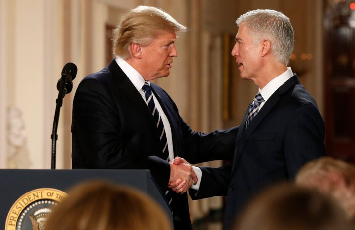 Donald Trump shakes hands with Neil Gorsuch after nominating him to be an associate justice of the U.S. Supreme Court on Jan.